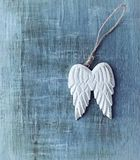 Angel Wings on hand painted, wooden background. Top view. Copy space royalty free stock images