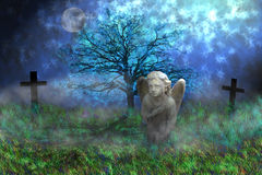 Angel with wings sitting on the mossy grass Royalty Free Stock Images