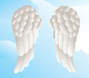 Angel wings with a sky background. An illustration of angel or dove wings Royalty Free Stock Photos