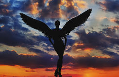 Angel with wings in the sky. Angel with white wings in the dramatic sky stock image