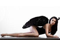 Angel with wings in white. Background Royalty Free Stock Images