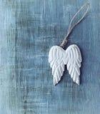 Angel Wings. Wooden angel wings on apinted wood stock image