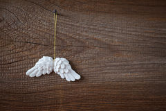 Angel wings. On wooden board stock photos