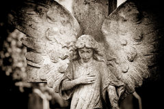 Angel With Hand On Heart Stock Photo