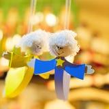 Angel Woman in Blue Dress Pendant Near Angel Woman in Yellow Dress Pendant Royalty Free Stock Images