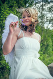 Angel woman with flower Stock Image