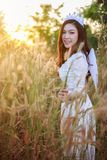 Angel woman in a grass field with sunlight. Beautiful angel woman in a grass field with sunlight Royalty Free Stock Image