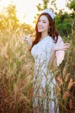 Angel woman in a grass field with sunlight. Beautiful angel woman in a grass field with sunlight Royalty Free Stock Photos