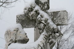 Angel with Wreath. A snow covered grave angel holding a wreath Royalty Free Stock Image