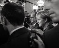 Angela Merkel en Francois Hollande na de vergadering over ASE Royalty-vrije Stock Afbeeldingen