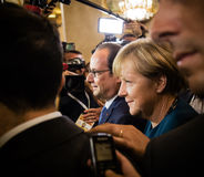 Angela Merkel en Francois Hollande na de vergadering over ASE Stock Fotografie