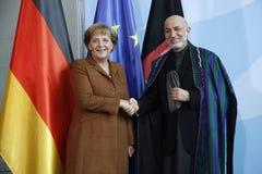 Angela Merkel, Hamid Karsai Royalty Free Stock Photos