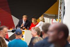 Angel Merkel in election battle 2017 in Heidelberg. Angela Merkel has been plastered with tomatos stock image
