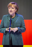 Angela Merkel holding a speech in front of the German flag Royalty Free Stock Photography