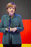 Angela Merkel holding a speech in front of the German flag Royalty Free Stock Images