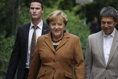 Angela Merkel with husband. SEPTEMBER 22, 2013 - BERLIN: German Chancellor Angela Merkel with her husband, Joachim Sauer, on their way to the ballot box on Royalty Free Stock Photos