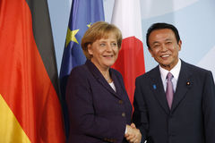 Angela Merkel, Taro Aso Stock Photos