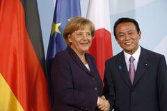 Angela Merkel, Taro Aso Stock Photos