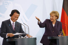 Angela Merkel, Taro Aso Stock Images