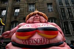Angela Merkel y economía de Alemania Imagen de archivo libre de regalías