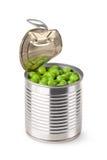 Angelehnte metallische Dose mit grünen Erbsen Lizenzfreie Stockbilder