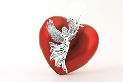 AngelHeart. Silver angel and red heart on white background Stock Photos