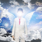 Angelic being. In white suit Stock Photo