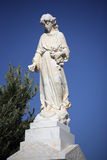 Angelic Cemetery Statue. Against blue sky Stock Photography