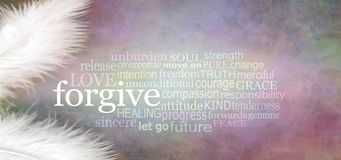 Angelic forgive Word Cloud Rustic Banner. Two white feathers with a FORGIVE word cloud between against a dark stone effect multicoloured rustic grunge background stock photo