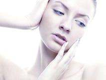 Angelic lady. Portrait of beautiful angelic lady on a white background Stock Image