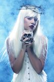 Angelic long hair woman with skull. Picture a beautiful angelic long hair woman with skull Royalty Free Stock Image