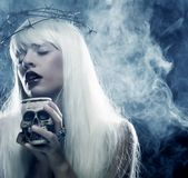 Angelic long hair woman with skull Stock Photo