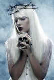 Angelic long hair woman with skull. Picture a beautiful angelic long hair woman with skull Royalty Free Stock Images