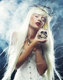 Angelic long hair woman with skull Royalty Free Stock Images