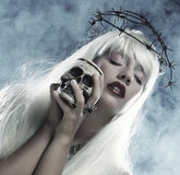 Angelic long hair woman with skull. Picture a beautiful angelic long hair woman with skull Stock Images