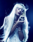 Angelic long hair woman with skull. Picture a beautiful angelic long hair woman with skull Stock Photos