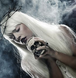 Angelic long hair woman with skull Royalty Free Stock Image