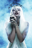 Angelic long hair woman with skull Stock Images