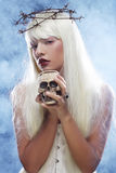 Angelic long hair woman with skull. Picture a beautiful angelic long hair woman with skull Stock Image