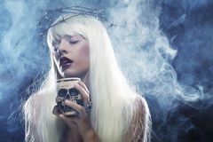 Angelic long hair woman with skull. Picture a beautiful angelic long hair woman with skull Royalty Free Stock Photo