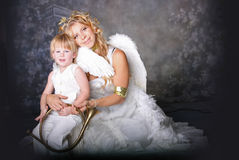Angelic Mother and Son. Pose with Brass Trumpet royalty free stock photography