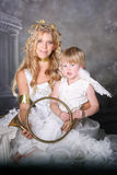 Angelic Mother and Son. Pose with Brass Trumpet royalty free stock image
