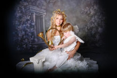 Angelic Mother and Son. Pose with Brass Trumpet stock photos