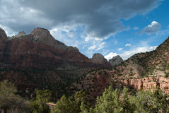 Angelic storm clouds rolling over Mt. Zion National Park mountains in St. George. UT Royalty Free Stock Photos