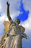Angelic victory statue. On the blue sky background Royalty Free Stock Photo