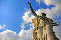 Angelic victory statue. On the blue sky background Royalty Free Stock Images