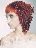 Angelic woman. Portrait of a young angelic woman with red hair Stock Photos