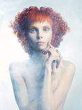 Angelic woman. Picture a beautiful angelic woman in the fog Royalty Free Stock Images