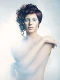 Angelic woman. Picture a beautiful angelic woman in the fog Stock Photography