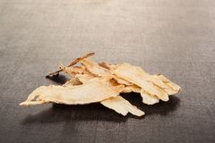 Angelica root on black. TCM. Angelica root used in chinese traditional herbal medicine over black background. TCM stock photos